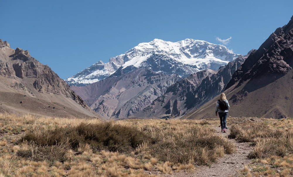 Single hiker following trail to Aconcagua Mountain