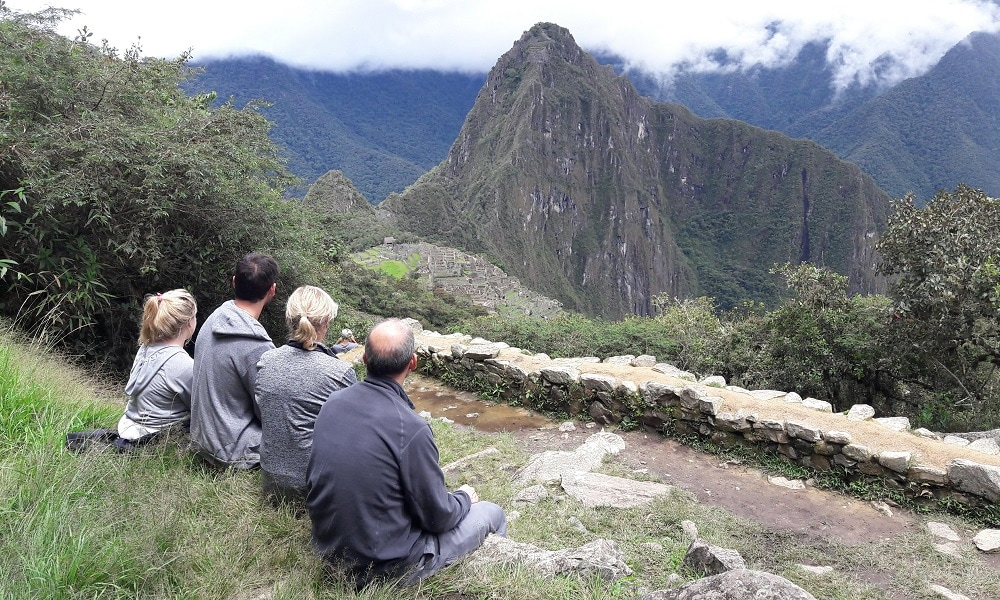 Group of trekkers overlooking Machu Picchu from a vantage point