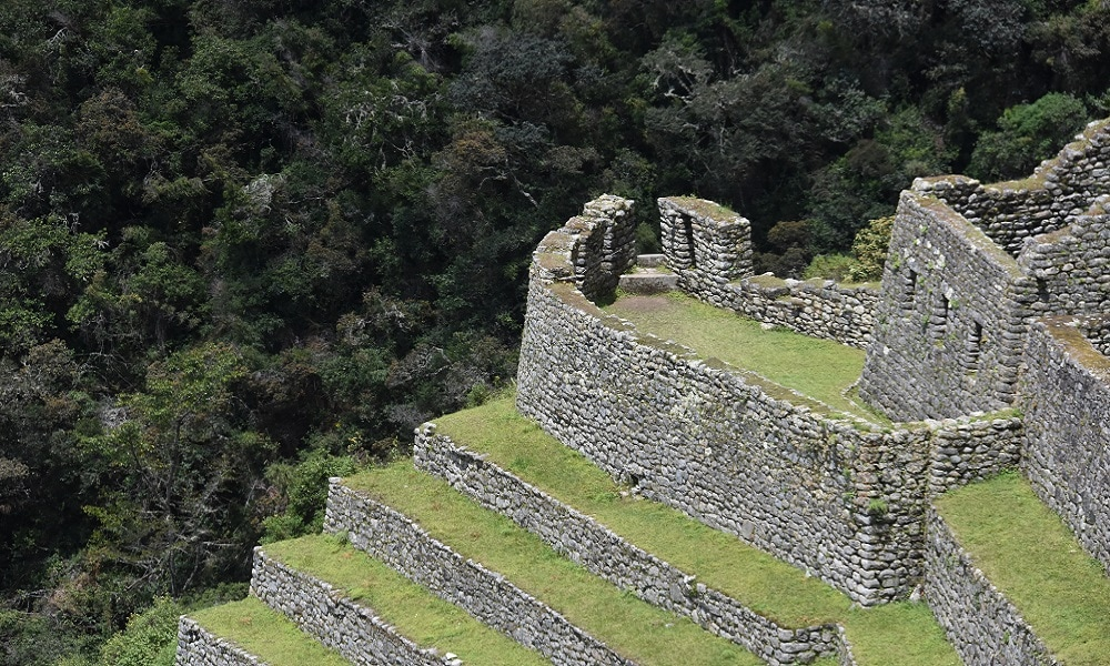 Photo of Inca Ruin with cloud-forest in the background