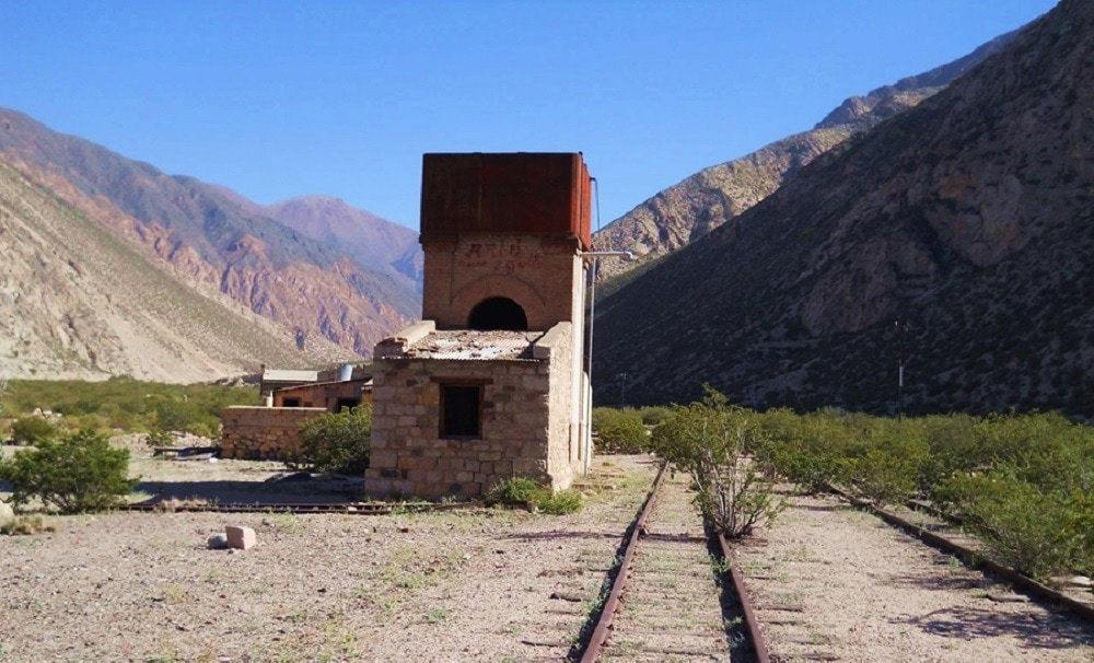 Valley with railroad and brick bilding
