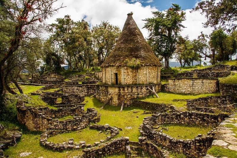 Ancient lodging or store room set in green surroundings at Kuelap in Peru