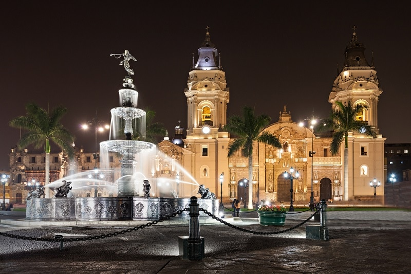 night time picture of Lima Cathedral with fountain at the front.