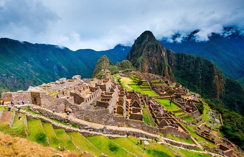 Panoramic photo of Machu Picchu with cloudy sky