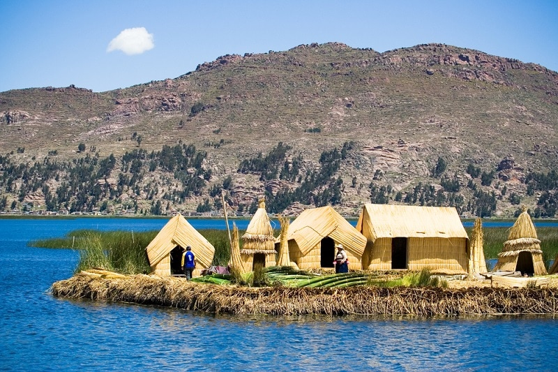 straw houses on a floating island