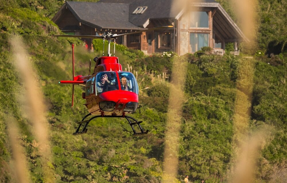 Red Helicopter arriving at hotel Mari Mari